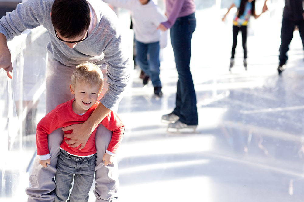 Dad skating with boy